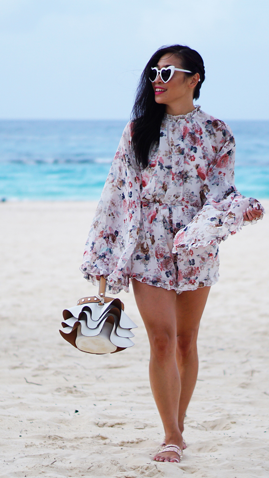 How to Travel More Often #outfitpost #stylepost #waderlust #resortwear #traveltips #traveladvice #travellingmore #savingtips #travelingtips #solotravel #couplestravel #shein #romper #floralromper #backlessromper #backlessfloral #backless #rufflebag #sunglasses #heartsunglasses